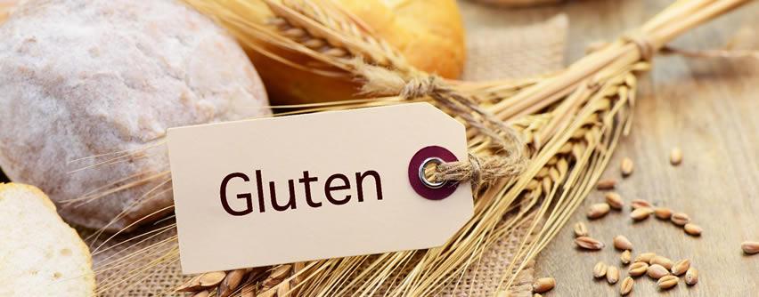 Foto alimentos con gluten y cartel en el que pone gluten